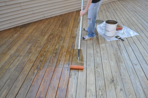 applying-a-deck-sealer-using-a-roller